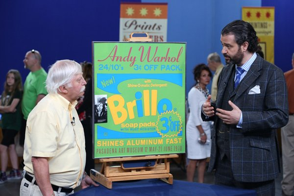 Nicholas Lowry (right) appraises a 1970 Andy Warhol poster for $3,000 to $4,0...
