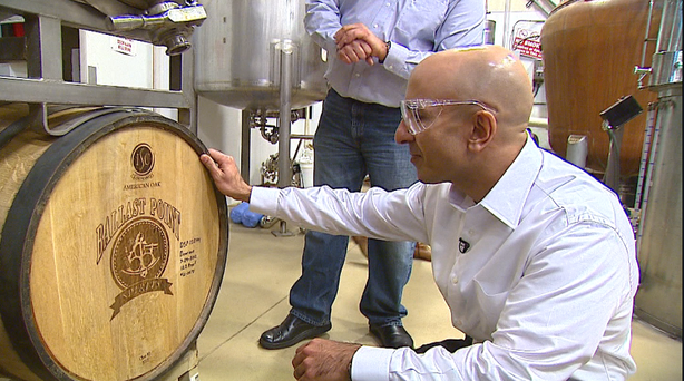 At Ballast Point, California gubernatorial candidate Neel Kashkari tasted a few beers and purchased a six-pack of Calico Amber Ale.