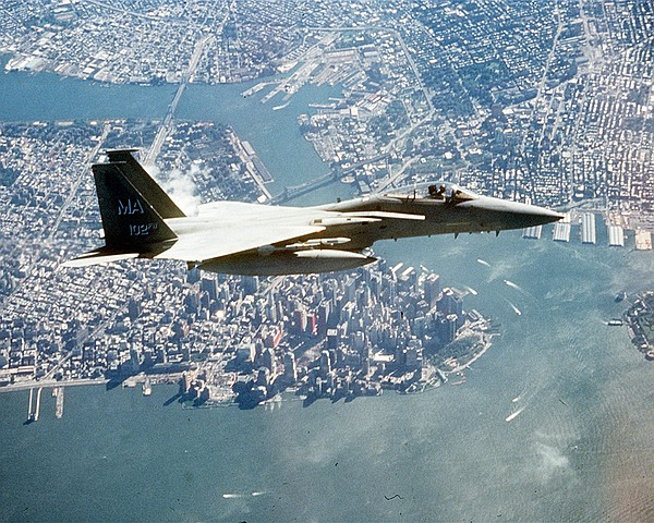 An F-15 flies over lower Manhattan during an Operation No...