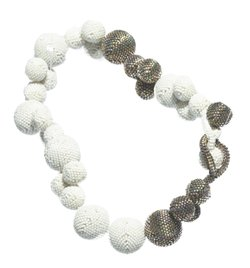 William and Steven Ladd also design and create jewelry. This is Cloud 1: Beaded Ball Necklace.