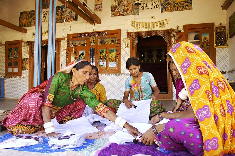 Kakuben Jivan Ranmal working with other textile artisans at the Self-Employed...