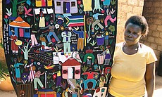 Meriam Baloyi with her Crime embroidery, inspired by the burglary of the artist's home, South Africa, 2010.