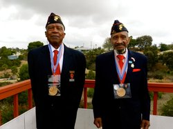 Retired Gunnery Sergeant J.T. Inge, left, and Retired First Sergeant Joe Earl Jackson proudly display their Congressional Gold Medals awarded in 2012 for their service as Montford Point Marines.