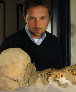 Presenter Michael Scott and skeleton from x tombs, Bordeaux University.