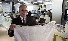 KPBS General Manager Tom Karlo holds up a piece of fabric Christo and Jeanne-...