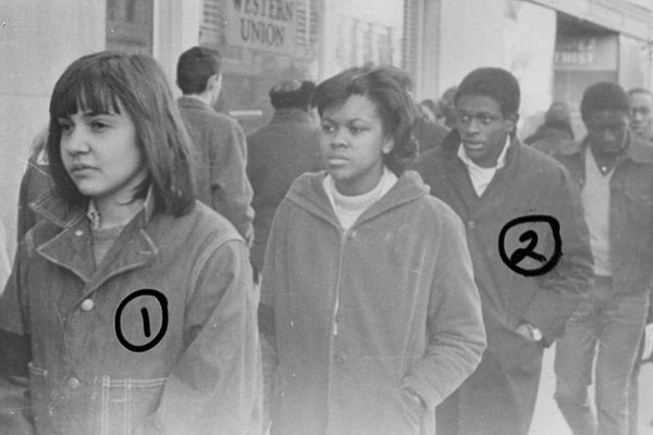 Photograph of people marked with numbers.