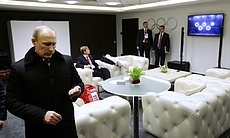 Russian President Vladimir Putin waits in the presidential lounge to be intro...
