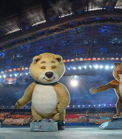 The 2014 Sochi Winter Olympics official mascots, the Leopard, the Polar Bear, and the Hare take part in the ceremony.