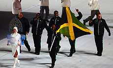 The crowd goes wild: Bobsled racer Marvin Dixon and the Jamaica Olympic team got a a warm welcome as he carried his country's flag Friday.