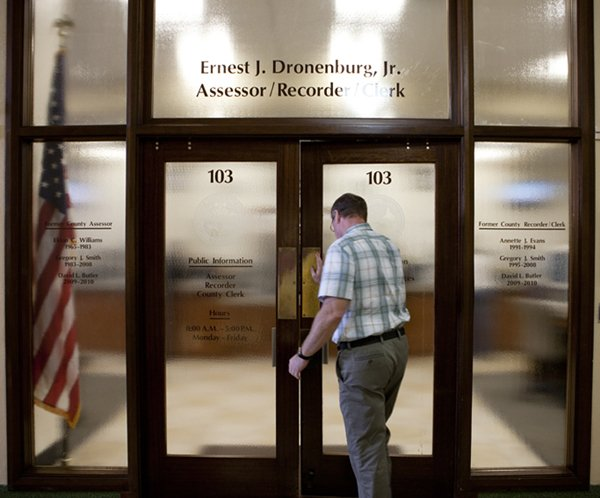 A man walks into the San Diego County's Assessor and Recorder office in the C...