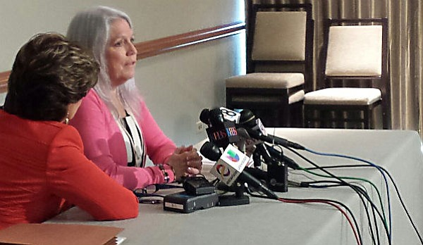 Irene McCormack Jackson, right, speaks to reporters with her attorney, Gloria...