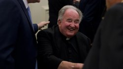 Father Joe Carroll shakes hands at Kevin Faulconer's election night party on Feb. 11, 2014.