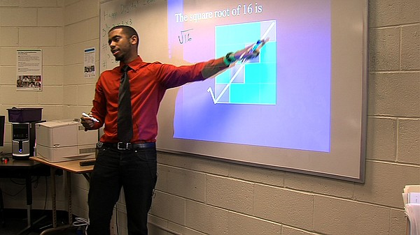 GED Instructor Trenton Watkins introduces his students to...