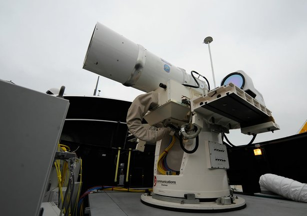 In this July 30, 2012 photo provided by the U.S. Navy, a laser weapon sits t...