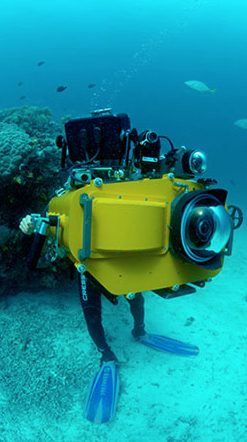 Underwater director of photographer Howard Hall in West Papua with the IMAX camera and underwater housing, which together weigh 250 pounds.