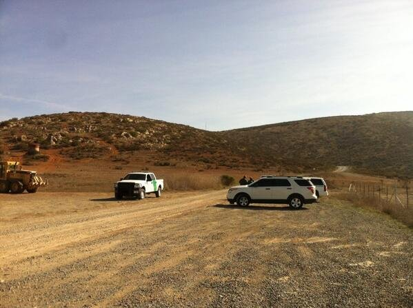 U.S. Border Patrol agents monitor the road leading to where a suspect was sho...