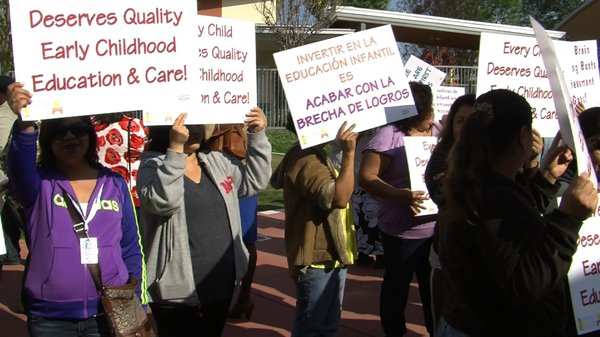 Parents held up signs about the importance of early childhood education at a rally kicking off a statewide bus tour. They are calling on Gov. Jerry Brown to support increased funding for state preschool programs and expanded early kindergarten.