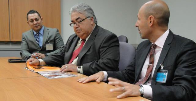 In this undated photo, Sen. Rob Calderon (center) reviews information regardi...
