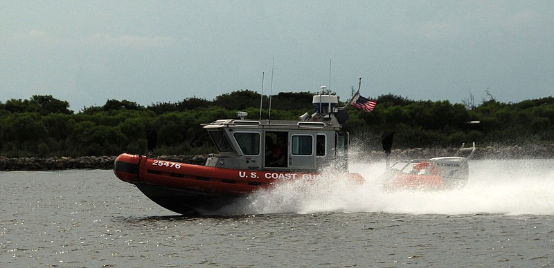 A Coast Guard boat crew patrols the water at Port Fourchon, La.