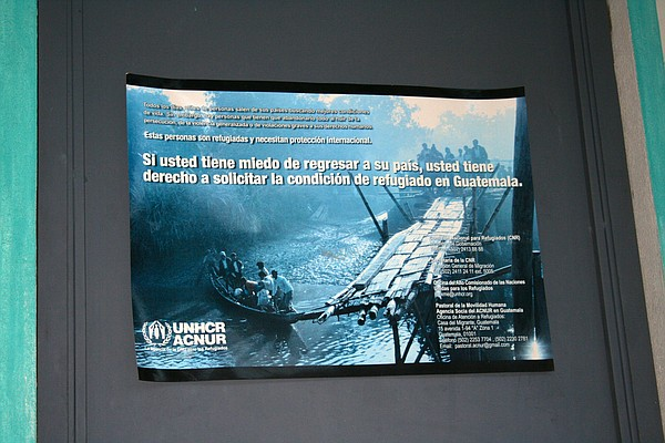 A poster at a migrant shelter in Guatemala City advises p...