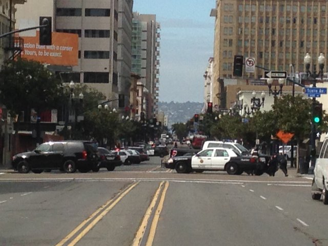 San Diego police cruisers block streets off in the East Village after a man w...