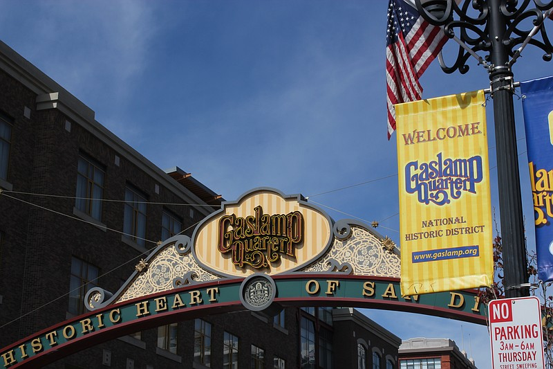 A sign hangs over the entrance to the Gaslamp Quarter on Fifth Avenue in down...