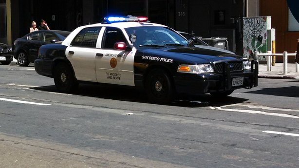 San Diego police stop busy traffic downtown.