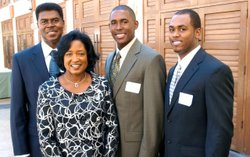 Vickie Turner standing with her husband, George Turner, and two of her three sons, Marcus Turner and Maurice Turner.