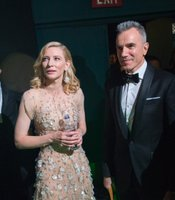Backstage moment: Cate Blanchett with water after her win, with Daniel Day-Lewis.