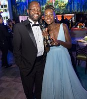 Family seemed a theme at this year's Oscars as nominees brought moms, dads, kids, and sibling. Here winner Lupita Nyong'o with her father Peter Anyang'Nyong'o.