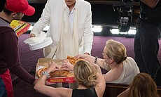 Meryl Streep helps herself to pizza.