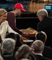 Not even the pizza guy bringing some pie to the celebrities could make the night better.
