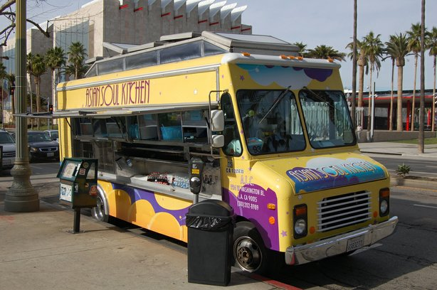 A food truck parked on the corner is open of business. The 78 food truck oper...