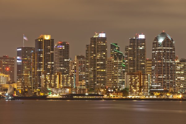The downtown San Diego skyline is seen at night.