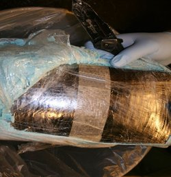 Above: One of the bundles containing narcotics seized from the scene, March 3...