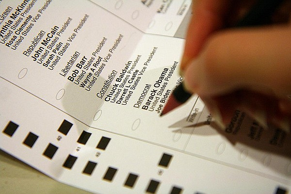 A voter fills in a 2012 mail-in ballot.