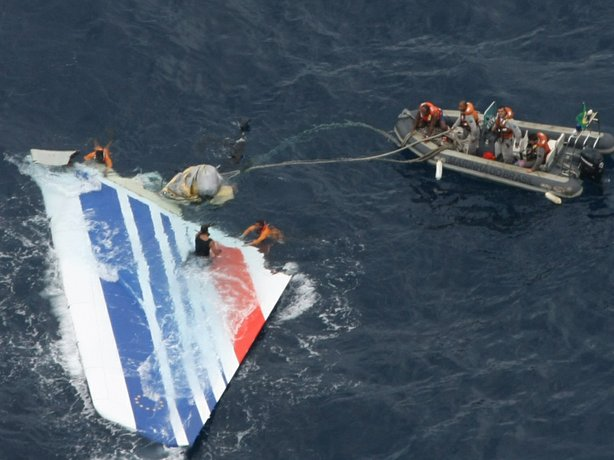 Brazil's Navy sailors recover debris from the Air France Flight 447 in the At...