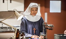 Sister Julienne (Jenny Agutter) in clinical room.