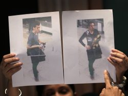 At a news conference Tuesday in Sepang, Malaysia, authorities held up picture...