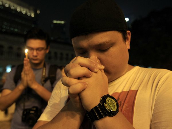 In Kuala Lumpur, people continue to offer prayers for the...
