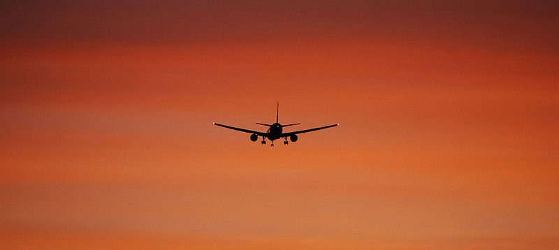 A Boeing 777 is silhouetted at dusk on May 21, 2012.
