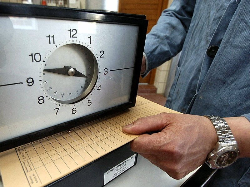Punching a time card: It's still one way of tracking hours worked. President ...
