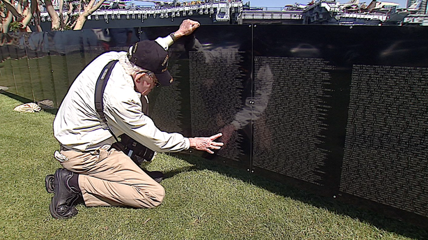 Marine Corps veteran Clint Griffin looks at the names of Americans who died i...