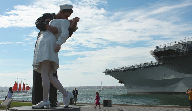"The ""Unconditional Surrender"" statue in front of the USS Midway."