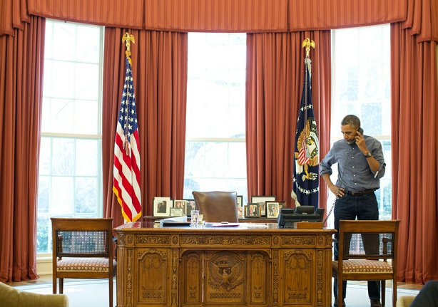 President Barack Obama talks on the phone in the Oval Office with Russian Pre...