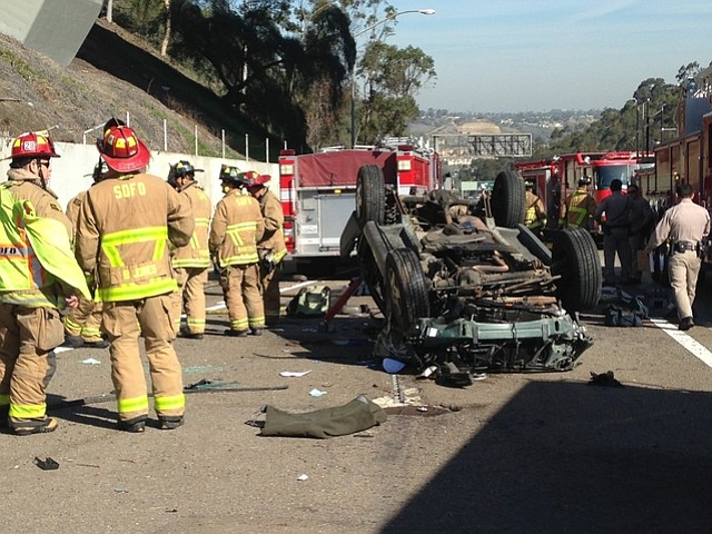 An SUV landed on another car on southbound Interstate 805 on Mar. 17, 2014.
