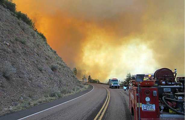 "The ""Poco"" wild fire jumps Fire Road 512 on June 14, 2012 in the Tonto Nation..."