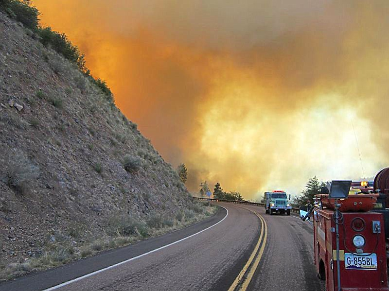 """The """"Poco"""" wild fire jumps Fire Road 512 on June 14, 2012 in the Tonto Nation..."""