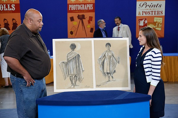 Meredith Hilferty (right) appraises John Biggers drawings...