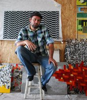 "Jaime Ortiz, also known as ""Ruizcycle,"" is surrounded in his studio by art pieces made from discarded industrial material."